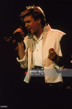 Singer Simon Le Bon of the British pop group Duran Duran performing on stage during a concert, 1984.