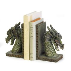"Your most treasured tomes will remain upright with these mythical dragon guardians! Richly rendered in astonishing detail, these bookends add a mystical decorative touch to any room. Each is 10¼"" x 3¼"