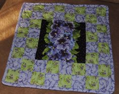 A personal favorite from my Etsy shop https://www.etsy.com/listing/254718096/mini-quilt-mug-rug-candle-mat-pansy