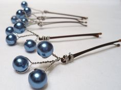 Delicate teal blue glass pearlized and decorative wire adorn metal hair pins. These hair pins are perfect for weddings including bridesmaids and flower girls, birthdays or and other special occasion.