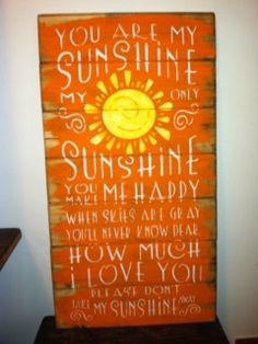 You are my sunshine sign 13 x 24 1/2 hand-painted wood sign. $32.00, via Etsy.