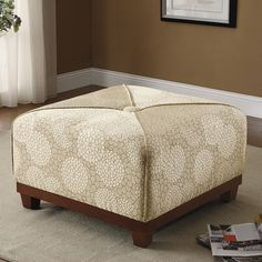 Bringing soft and decorative style to influence your room's decor, this upholstered cocktail ottoman will accent your space with a soft and graceful style. Durably built with a solid wood frame, this upholstered ottoman features a large cocktail construction that allows it to be used for a multitude of purposes. Pull it towards a sofa to rest weary feet, set a serving tray atop it for casual events or pull it to the side for additional guest seating. A decorative piece with elegant…