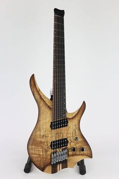 Skervesen Guitars Spalted/flame maple top, european ash wings, 7pc wenge-maple-bubinga neck, 2pc snakewood-ebony fretboard on SkerveTEN7 headless guitar. — with GHS Strings, Jescar Enterprises, Bare Knuckle Pickups, MeraGuitars, Jim Dunlop Guitar Products and Hipshot Products Inc.