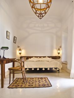 Riad Tchaikana - serene neutral bedroom with Moroccan style
