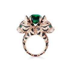 Boucheron Welcome 'Fuzzy', the leopard cat. With a centrally mounted green cushion tourmaline, in rose gold, paved with Champagne diamonds.