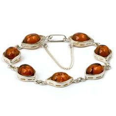Sterling Silver Amber Round Shape Bracelet 7 Inches GRACIANA. $60.98. All amber jewelry designs are from Eastern Europe