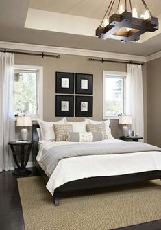 This bedroom is stunning! @Barbara Acosta Wirth Art applauds the pictures grouping --- strong, wide black frames, expertly hung close together, repeating the square lines of the chandelier. Nice design!