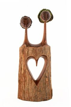 Hearts Connected Sandalwood Statue Each statue is handcrafted by a Fair Trade Master Carver in Mozambique, Africa and begins with the artisan choosing the perfect piece of the very aromatic golden Sandalwood to create his work of art.  The piece slowly takes shape as the artisan works the wood to ultimately create a carving that connects two lovers by a heart.  One figure features a colorful head wrap for an exotic splash of color.