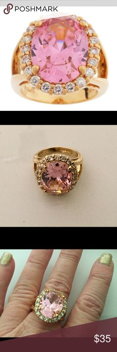 ⭐Gorgeous Jacqueline Kennedy Collection Ring⭐ Gold tone with large simulated center kunzite stone surrounded by a halo of clear stones! This is a statement piece! It is from the Jacqueline Kennedy Collection by QVC!, so I know it is of great quality! No signs of wear whatsoever! Approximately a size 9. Reports indicate this is a reproduction of the last ring JFK gave Jackie prior to his death. Jewelry Rings