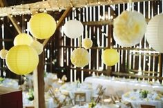 yellow and white lanterns in barn wedding reception, photo by Dan Stewart Photography