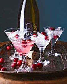 Kick-off your family Christmas with this refreshing, low-alcohol cocktail that contains a double dose of fresh cranberry. Whip up a batch of these festive drinks ahead and keep it chilled up to three days. #cranberryrecipes #fresh #frozen #holidaydrinks #cranberrycocktails #bhg