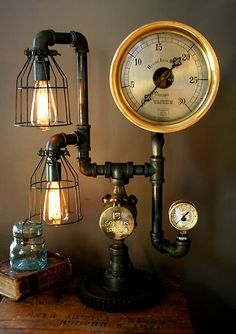 $849.00 Steampunk Lamp Light Industrial Art Machine. DIY with some copper pipes and fittings (or PVC primed and painted), a couple of gauges, two Edison lightbulbs, two light fixtures, and a clock glued/screwed to the end of a pipe fitting. Go for Goodwill and scrapyards as much as possible, maybe even use the base of an existing double lamp for stability and wiring.