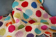 Polka dot hexagon blanket by Kate of the Greedy for Colour blog - she used the pattern from @Attic24 found here http://attic24.typepad.com/weblog/hexagon-howto.html