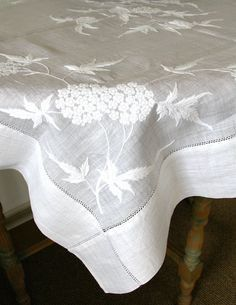 white table linen with large scale botanical motifs