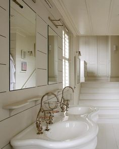 curvy double sink vanity. Design Sleuth: Picture Light as Over-the-Sink Illumination : Remodelista