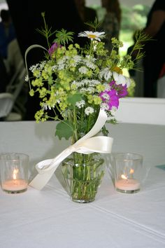 "Great green gift idea: request local friends with gardens, fields, and meadows to pick a variety of flowers to bring to your wedding. Have all drop off evening before or morning of and have  a ""flower fairy"" or two arrange the wildflowers into beauteous bouquets of seasonal delights!"