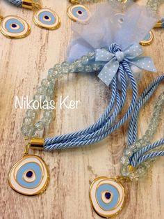 Μπομπονιέρα γούρι-μάτι.  (Χρώματα σιέλ, ροζ, εκρού) www.nikolas-ker.gr