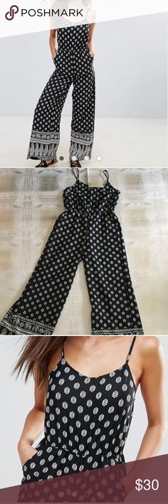 NWT Black and White Animol Jumpsuit - Size 6 Loose fitting and fun jumpsuit. Adjustable straps, elastic waist and wide legs. ASOS Pants Jumpsuits & Rompers