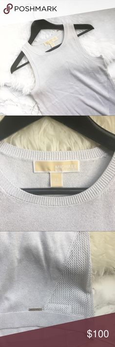 Michael Kors metallic sleeveless sweater NWT Super cute Michael Kors metallic white sleeveless hi low sweater with mesh details. This is new never worn. The tag fell off of the sweater but I still have it. No trades Michael Kors Sweaters