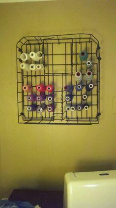Old dishwasher rack holds serger thread!