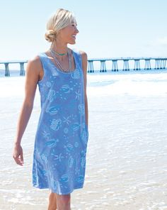 Our Sun Dress will be your easy-going summer favorite. Up to date details include skinny bra-friendly straps and inset pockets. 100% cotton, machine wash cold, made in the USA, crescent-shaped front pockets, bra-friendly straps, above-knee length