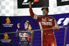 Vettel triumphs at night in Marina Bay