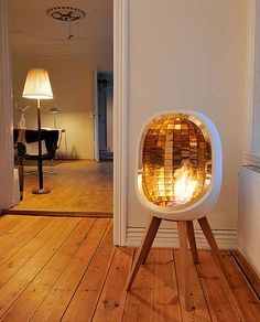 Tiny portable fireplace, love the gold inside.
