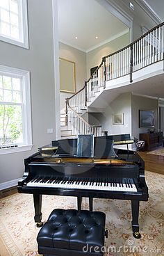 Fancy stair case is an amazing background for  elegant piano