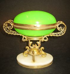 A French 19th Century green opaline galss egg box with ormolu mounts and marble base
