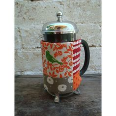 French Press Cozy. Quilters batting, cute fabric, and Velcro or button closure.