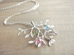Family Tree Necklace in Silver with Birthstones - Sterling SIlver Chain - up to 4 (Four) birthstones - kids, mom, grandmother, Mother's Day by Beazuness on Etsy https://www.etsy.com/listing/91997404/family-tree-necklace-in-silver-with