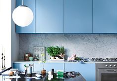 What's the secret to successfully wedging a kitchen into a 258-square-foot apartment? A visual balancing act.
