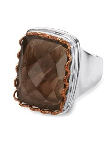 "Bansela Smokey quartz ring in silver overlay with copper bezel... A generous sized genuine smoky quartz brings a warm sparkle with an earthy copper bezel. Silver overlay band and gallery. Top of ring is 3/4"" x 1"""