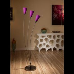 Stunning tulip standard floor light with purple glass conical shades.  A truly stunning item with 3 beautiful glass shades and heavy nickel chrome base.  Made by Europe's top lighting manufacturer, please do not confuse with cheap Asian copies.