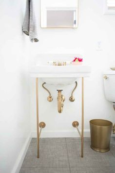 Give your wall-mount sink an elegant upgrade with gold legs.