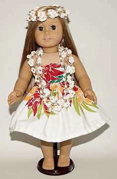 "Handmade in our shop in Hilo (Hula Capital of the World) is this Hula outfit for your American Girl Doll (or any 18 inch doll) modeled here by 2014 American Girl Doll of the Year, ""Isabelle"". The outf"