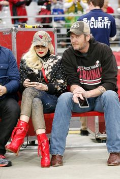 Gwen Stefani wearing  Givenchy Embellished Floral Satin Bomber, Dsquared2 Patent Boot, 47 Brand Arizona Cardinals NFL Realtree Camo Clean Up Cap, Bandolier Sarah Black and Silver Iphone Case, Dsquared2 Mud Print Cropped Jeans