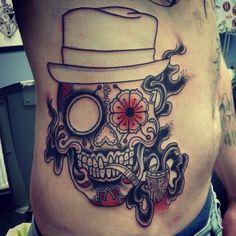 8 unique sugar skull tattoo ideas for guys. #tattoos #sugarskulltattoos #tattooideas #tattooswag #tattoosforguys