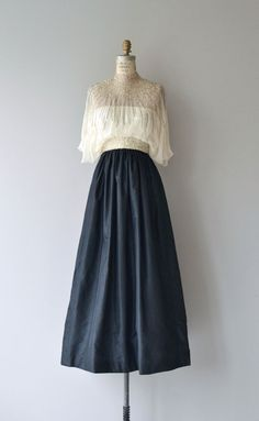 Vintage 1970s Alfred Bosand gown with sheer silk bodice detailed with light & dark silver bugle beads, fitted waist with beaded belt detail, long