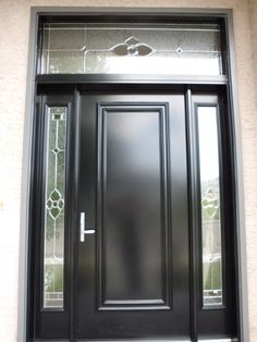 Star glass insert by Trimlite, Black coloured single entry door with two sidelites and transom.