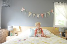 Love the cheerful colors and grey walls in this room