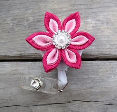 Retractable I.D. Badge Holder in Kanzashi Ribbon Flower with Pointed petals ID Badge Reel in Magenta Pink  and light Pink Color Combination by krantwist on Etsy https://www.etsy.com/listing/157160861/retractable-id-badge-holder-in-kanzashi