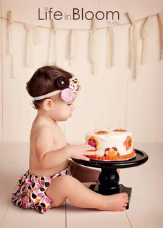 Cake Stand table for the bday - best idea ever.  and the headband and diaper cover rock!