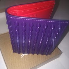 Christian Louboutin Paros Spike Men's Wallet BRAND NEW, never (ever) worn, authentic men's Christian Louboutin Spike Paros wallet. Received as a gift, has never seen a back pocket. Gorgeous bifold wallet with ID slot and coin pocket. Has all of original packaging, even the thank you card. :-) Christian Louboutin Bags Wallets