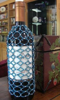 A wine cover enhances a wine gift, so much so that we have a Rotary Club customer who buys from us for their annual fundraiser wine auction because the cover nets them 30% more on average per wine sold. This is our Turquoise Blue Seed Bead Wine Cover. Think Spring parties, baby or wedding showers, so fun! There is a silver bead that connects the smaller turquoise glass beads at each juncture. Best works on the taller thinner style of wine bottles.