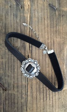 "Soft black leather with antique silver concho, choker 13.5"" adjustable, 1/2"" wide Handmade"