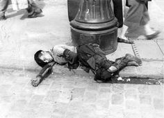 Warsaw, Poland, A boy lying on the pavement in the ghetto, 1941.