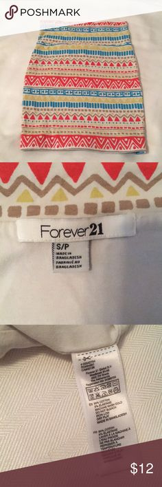Forever 21 Mini Skirt Size Small This Forever 21 Mini Skirt is Size Small and  96% Cotton, 5% Elastane.   Very comfortable, clean and cute! Multi color include teal green, orange, yellow, tan and white I have a necklace and bracket that matches in my closet — check it out! Bundle 2 or more and save on shipping & get 10% off! Thanks for shopping my closet! Forever 21 Skirts Mini