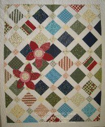 Crazy Christmas Quilt - uses 5 inch squares plus sashing and corner stones. Need to size up for a sofa size quilt
