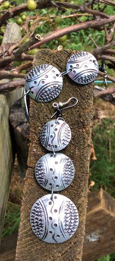 Masai textured metal dangle earrings. kenecoshop.storenvy.com